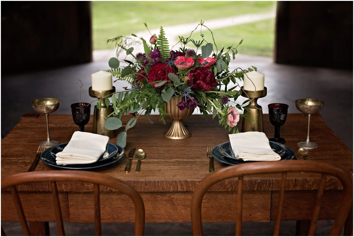 simple table setting with crimson floral centerpiece