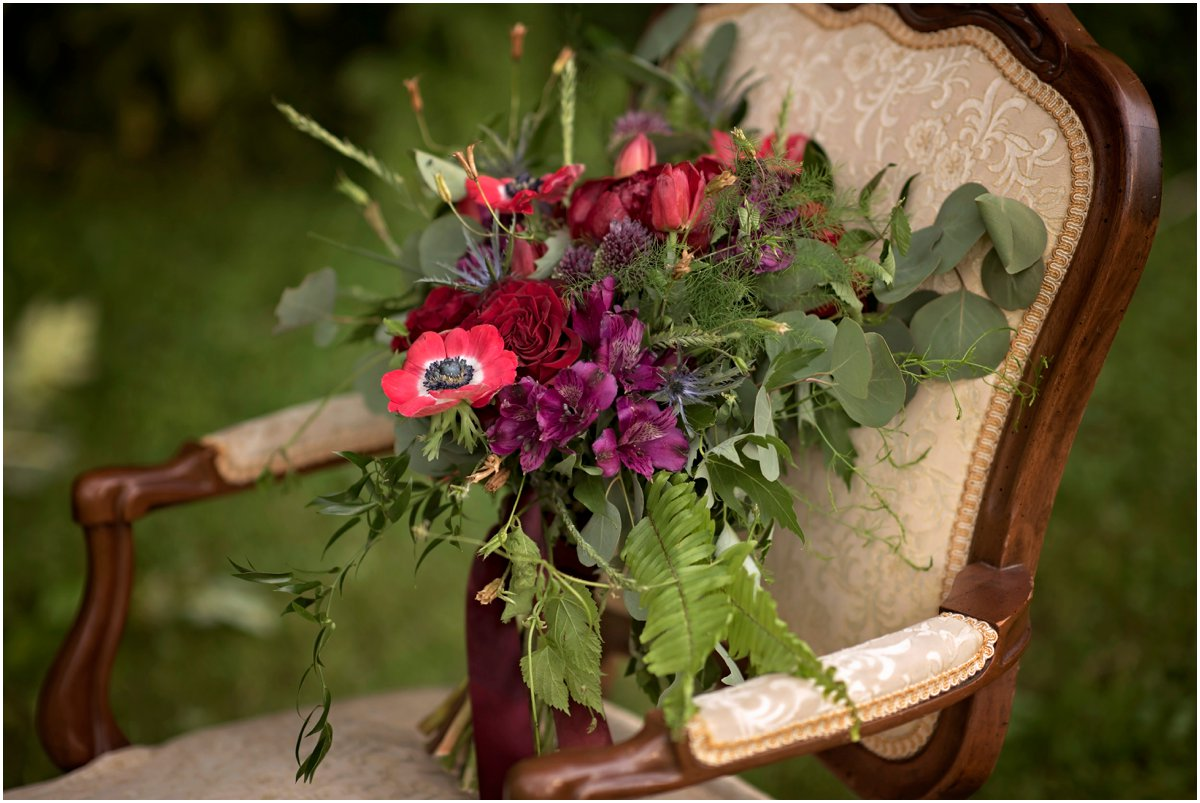 dark wildflower bouquet on vintage chair