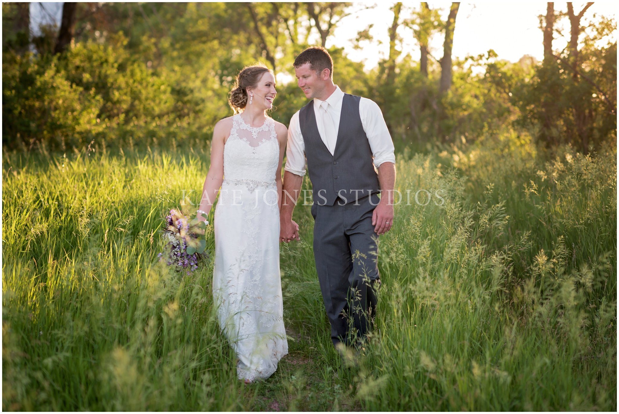 bride groom laughing in field on wedding day