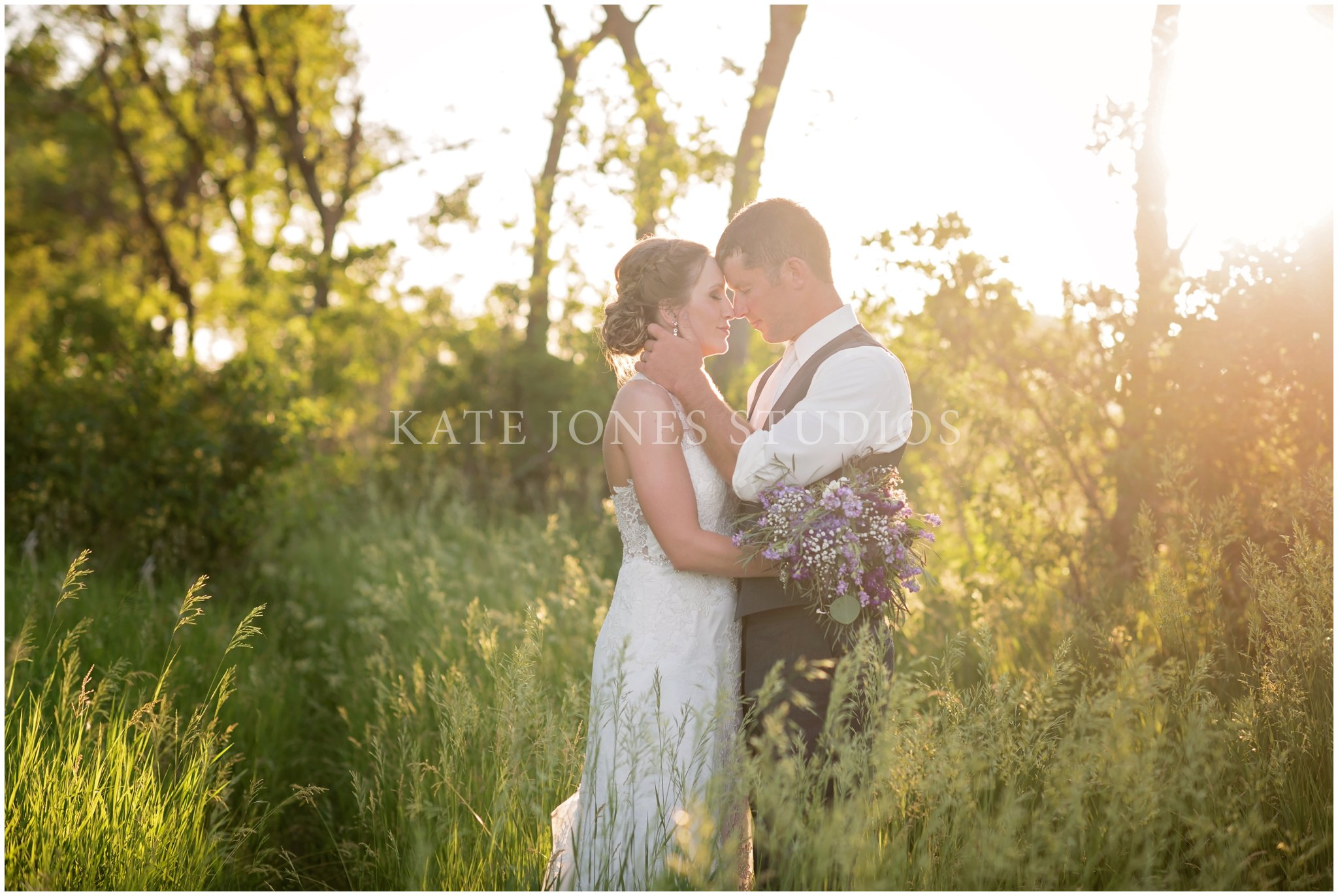 private moment for bride and groom at sunset