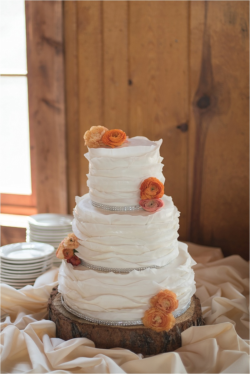 rustic orange floral wedding cake