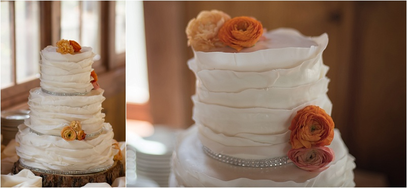 rustic orange and ivory floral wedding cake