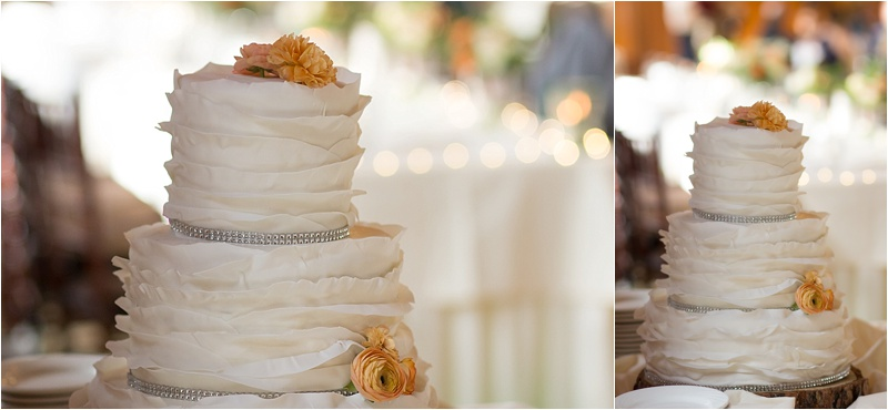 rustic orange and ivory floral wedding cake with bling