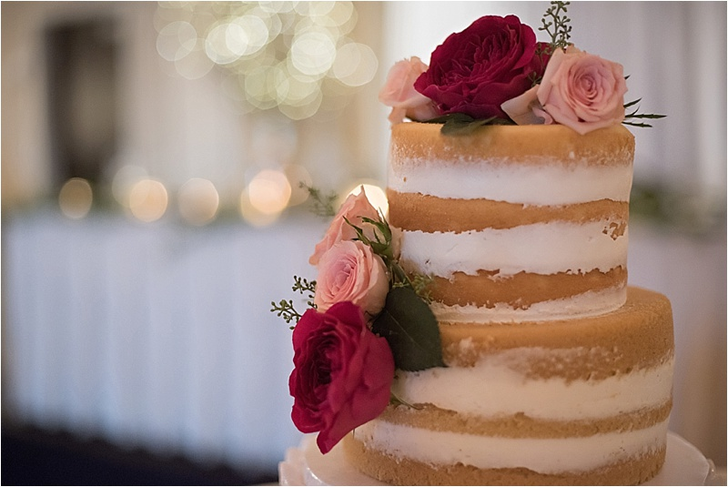 rustic glam wedding cake with floral accents