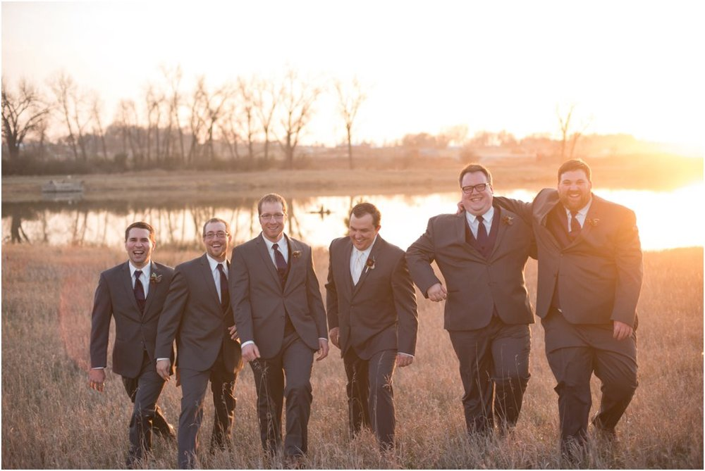 walking groomsmen at sunset