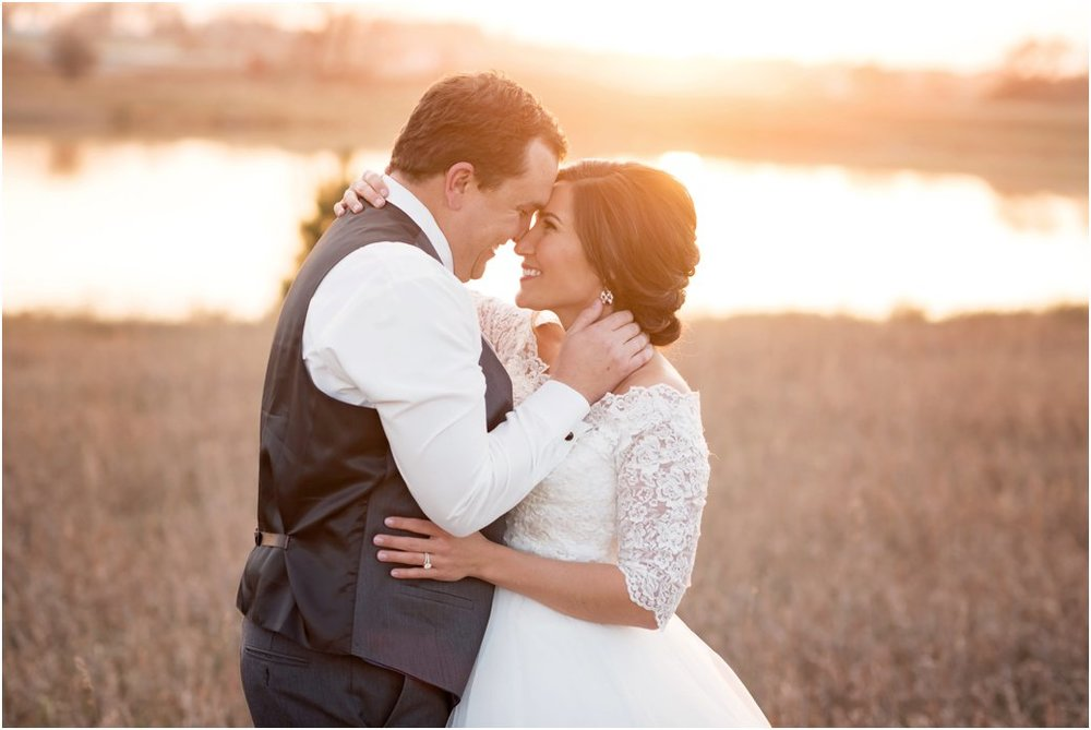 bride and groom in romantic embrace at sunset