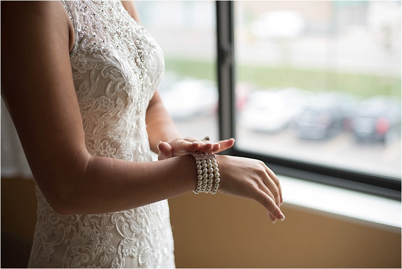 ivory lace wedding dress with pearl bracelet