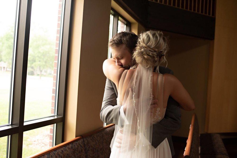 groom overwhelmed with emotion when seeing his bride