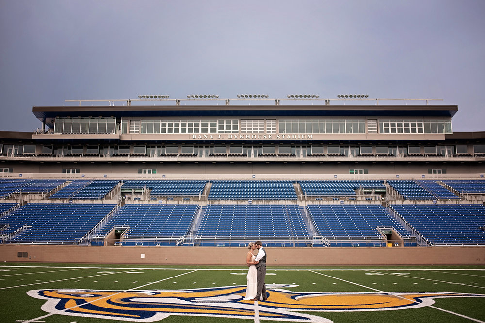 south dakota state university jackrabbit bride and groom on the fifty yard line