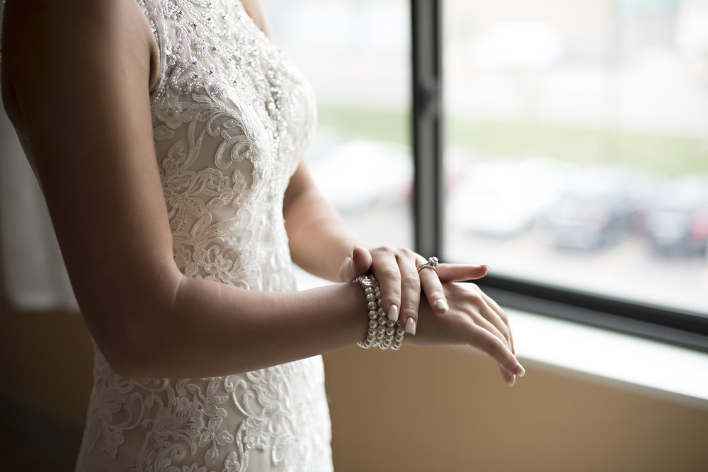 bride puts on bracelets before meeting groom
