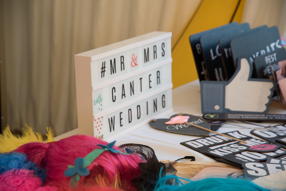 A light box displays Mr and Mrs Canter, on a table with lots of photo props for the wedding guests to use
