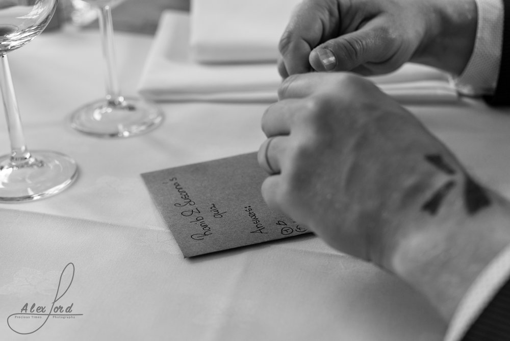 Close up image of a wedding guests hands during the start of the speeches
