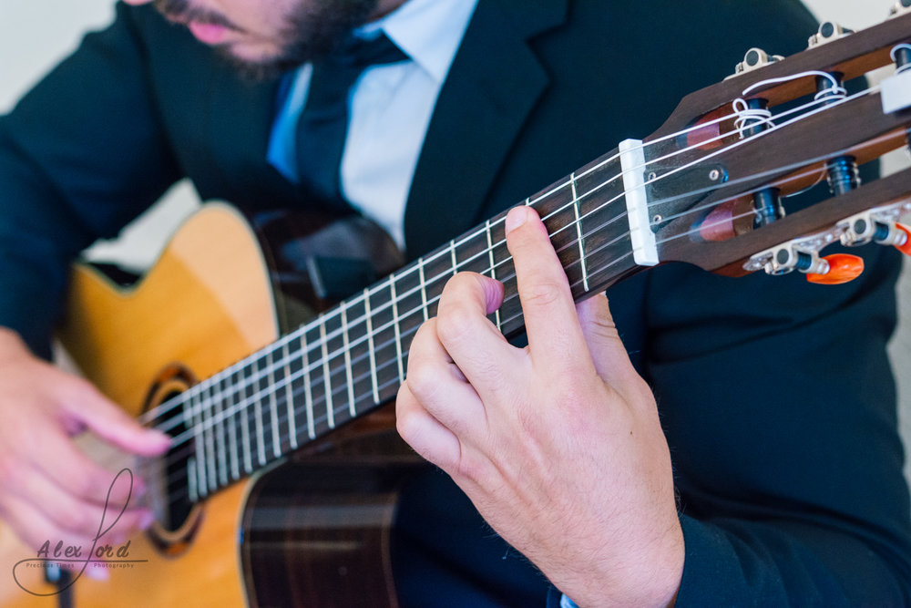 Close up of a guitarist playing music before the wedding ceremony