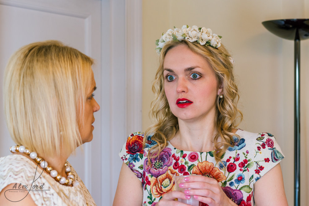 Bride chats to her friend before she gets ready to enter the wedding ceremony room