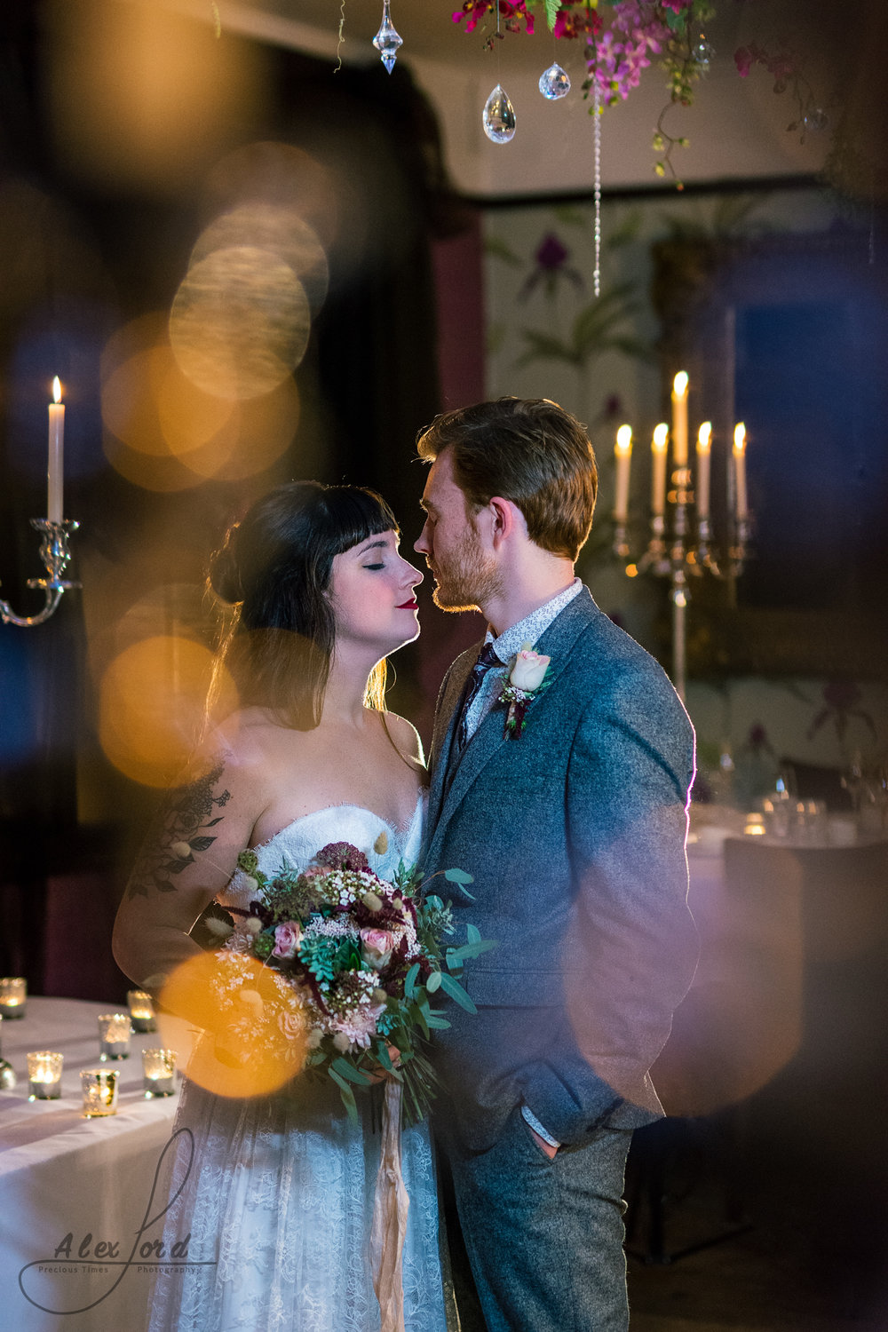 stunning bride and groom take a quiet moment together in their wedding venue