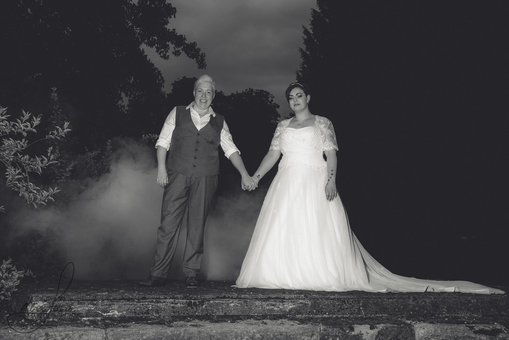 bride and groom have their photo taken with a smoke grenade