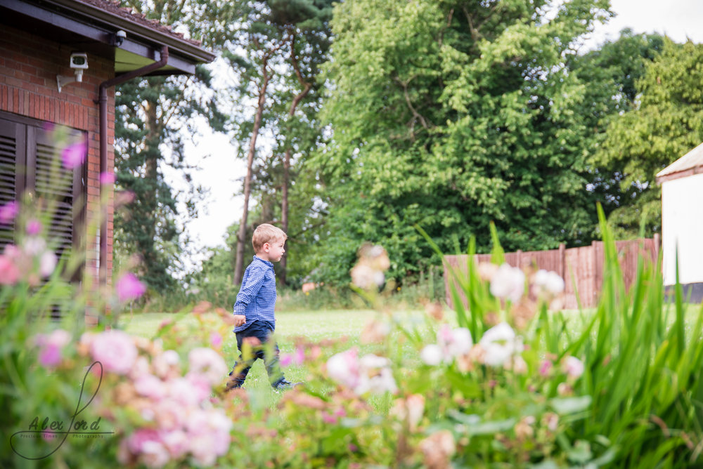 children play together in long grass at albrighton hall