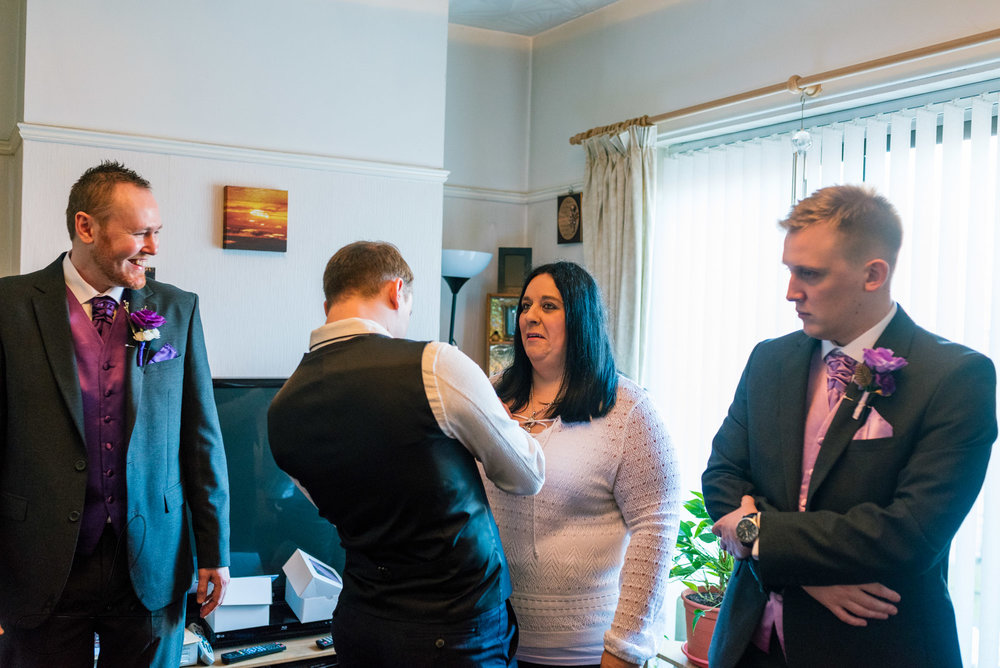 the groom spends some time with a few members of his family in his house, before leaving for his wedding ceremony in liverpool