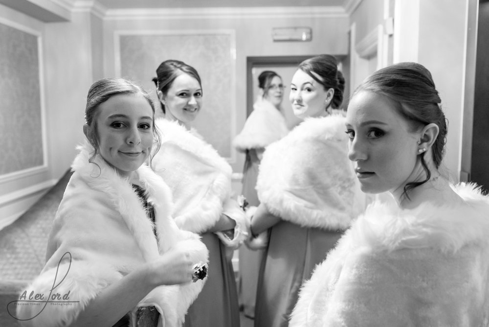 bridemaids gather in the hallway outside the wedding ceremony room