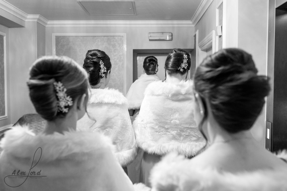 Shropshire wedding photographer captures the bridesmaids waiting outside the ceremony room