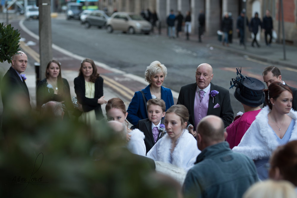 wedding guests stand outside the richmond hotel for their family photos