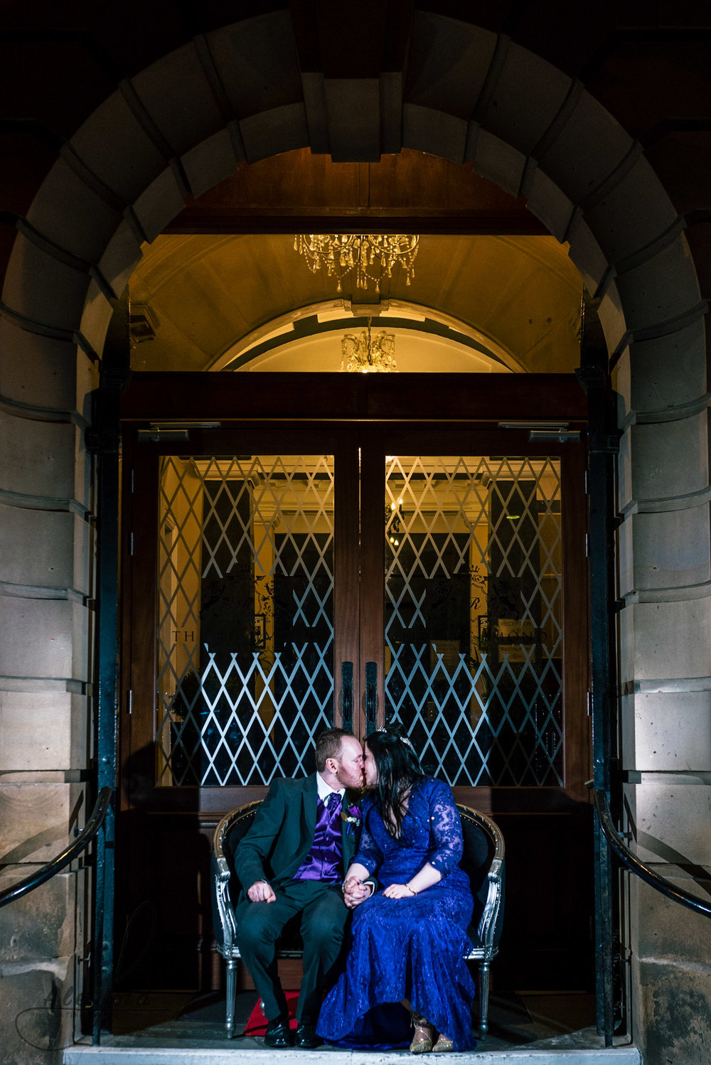 the bride and groom sit outside the richmond hotel for their evening photoshoot