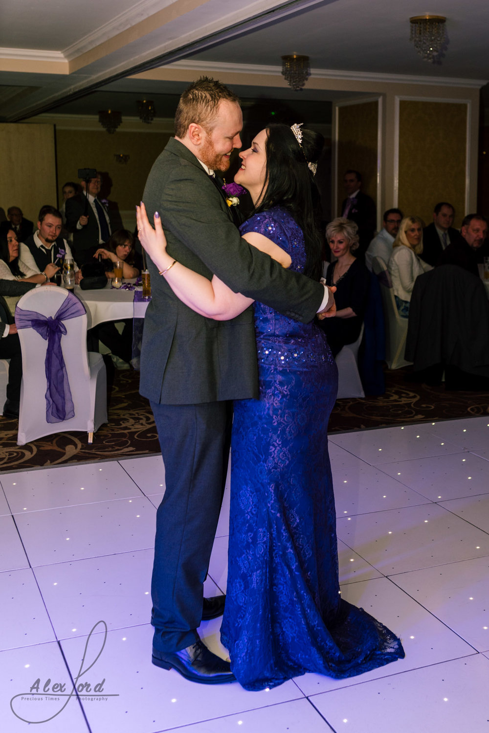 the bride and groom stand together on the dance floor for their first dance together as husband and wife