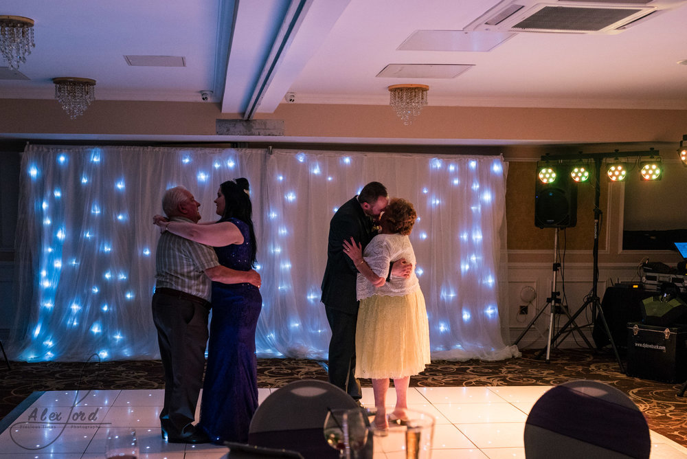 guests join the bride and groom on the dance floor after their first dance