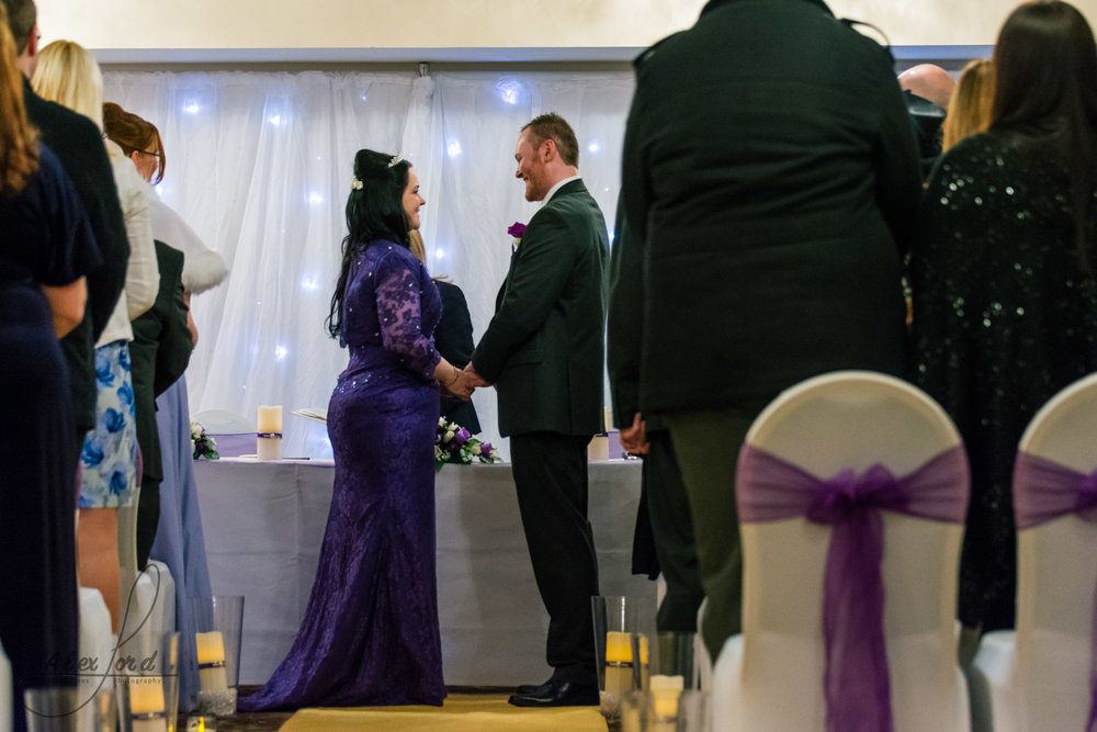 the bride and groom exchange their vows during their wedding ceremony