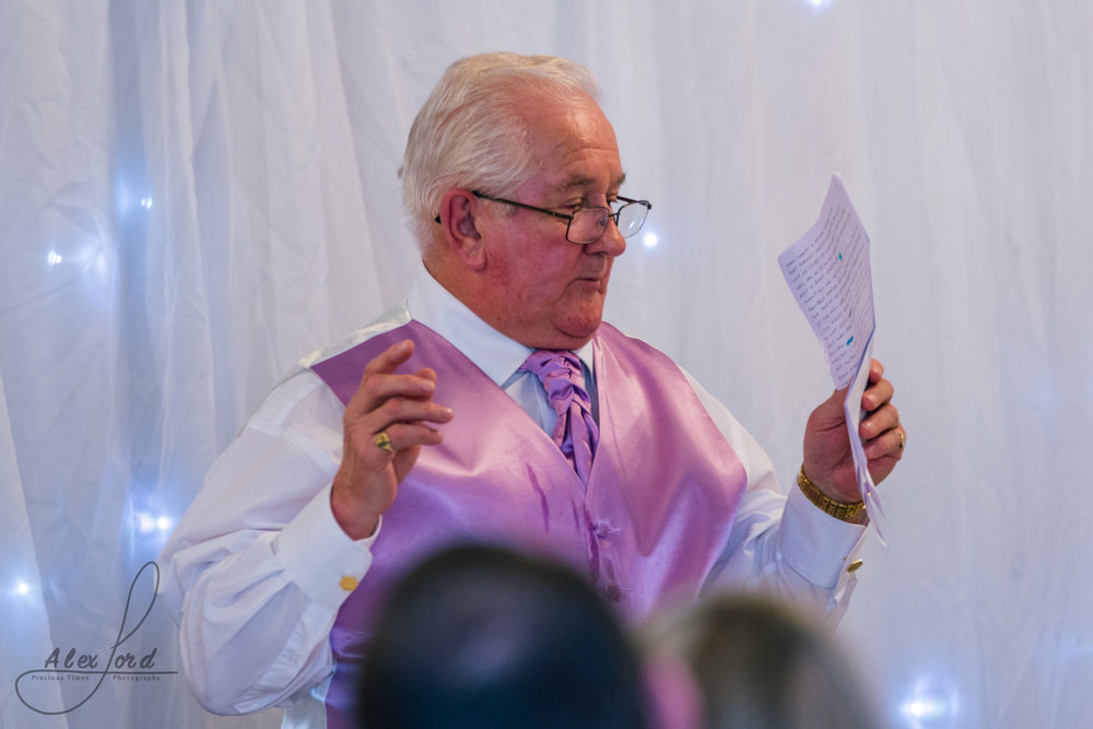 the father of the bride starts his speak at the beginning of the wedding breakfast