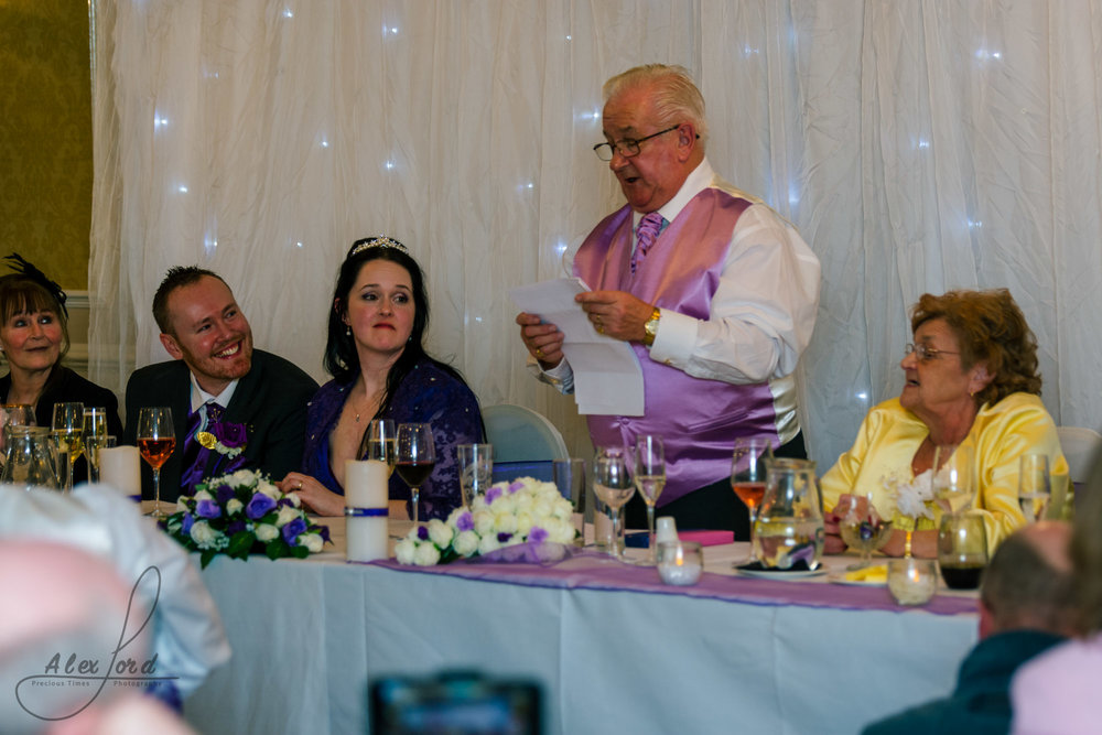 the brides father addresses wedding guests during his speech