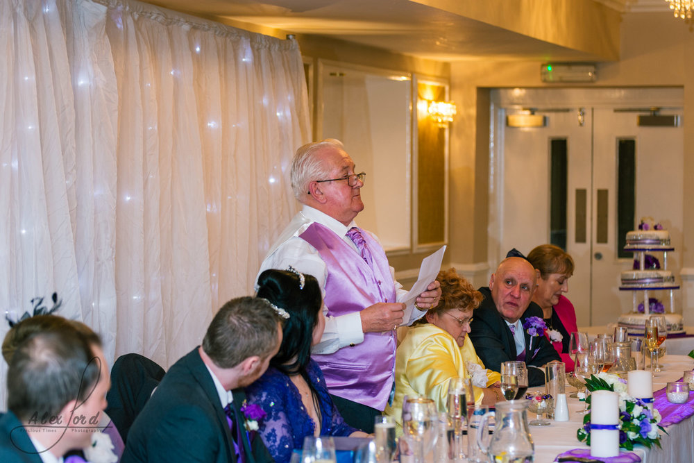 the brides father addresses his daughter during his speech