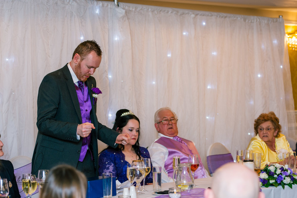 the groom stands up to make his speech to the wedding guests