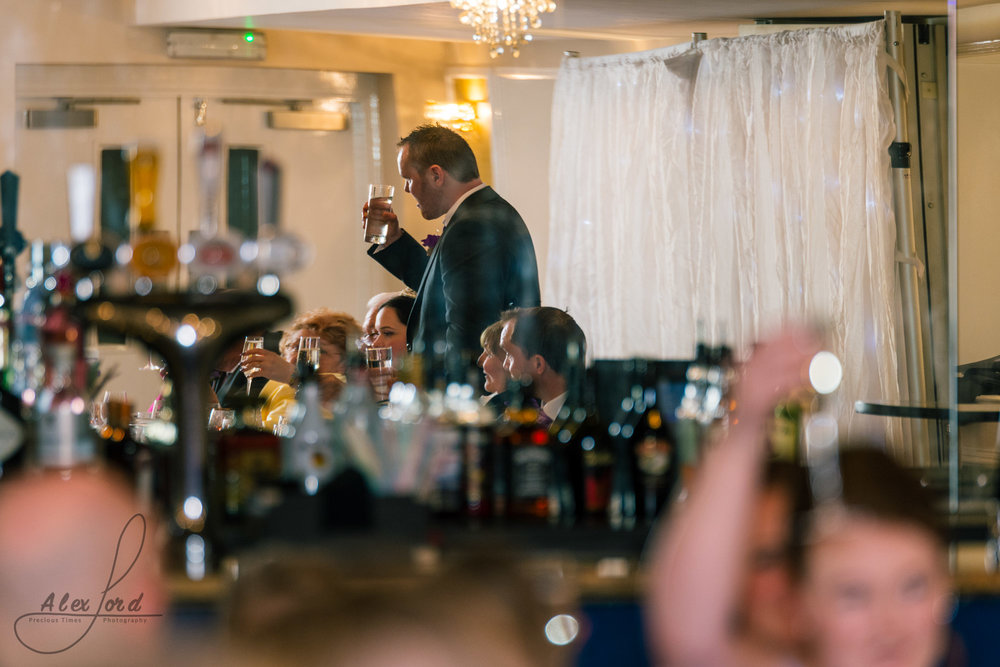 the best man stands to deliver his speech