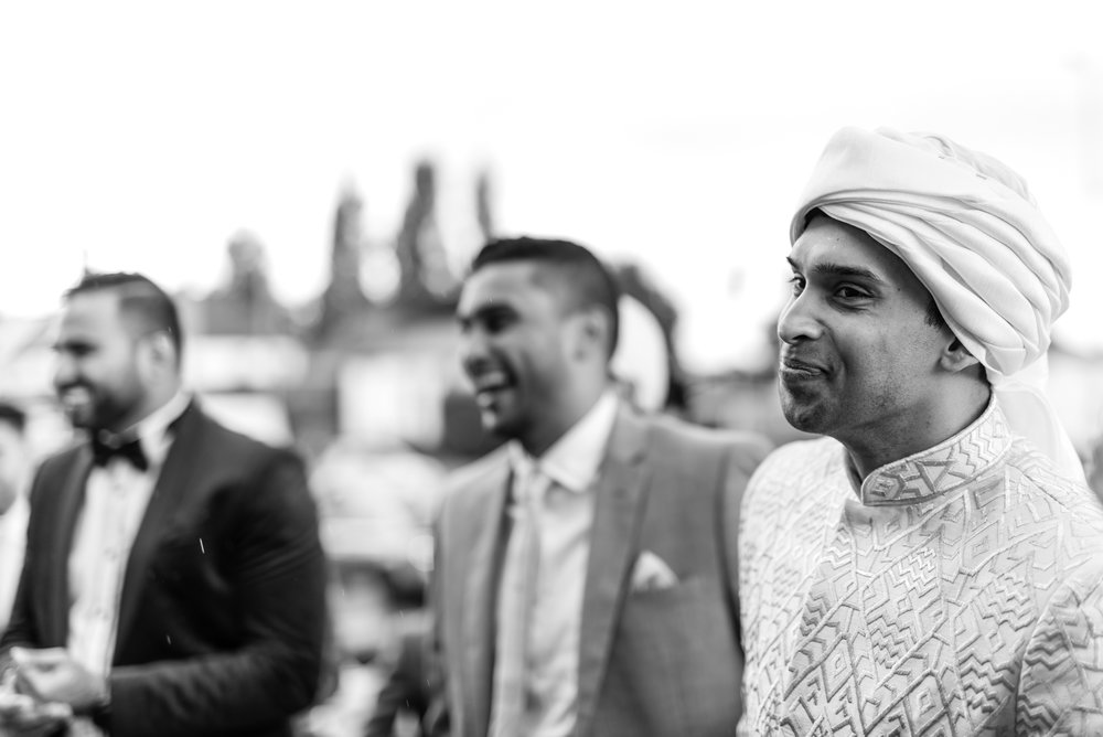 The groom arrives at the wedding venue with two of his friends
