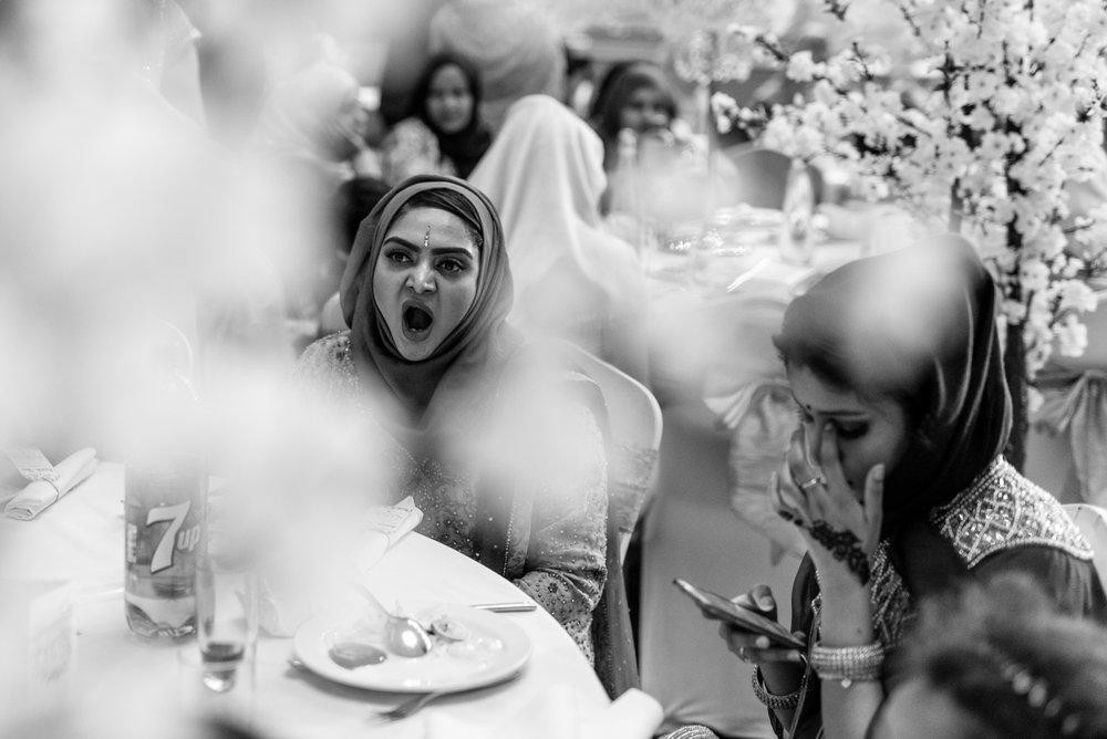Wedding guest looking forward to the ceremony