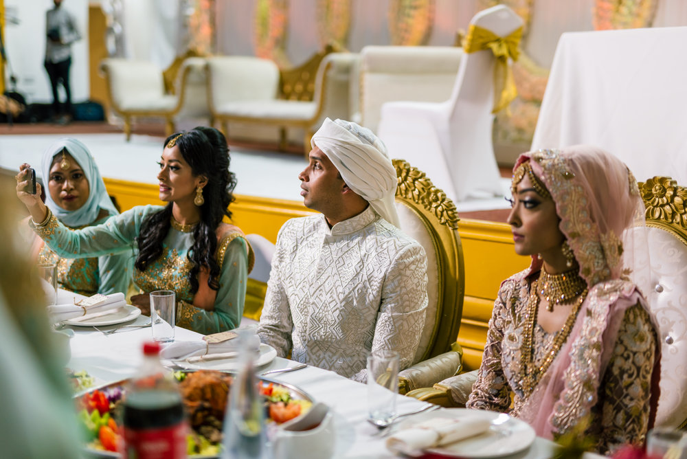 The bride and groom share their first meal together after the wedding