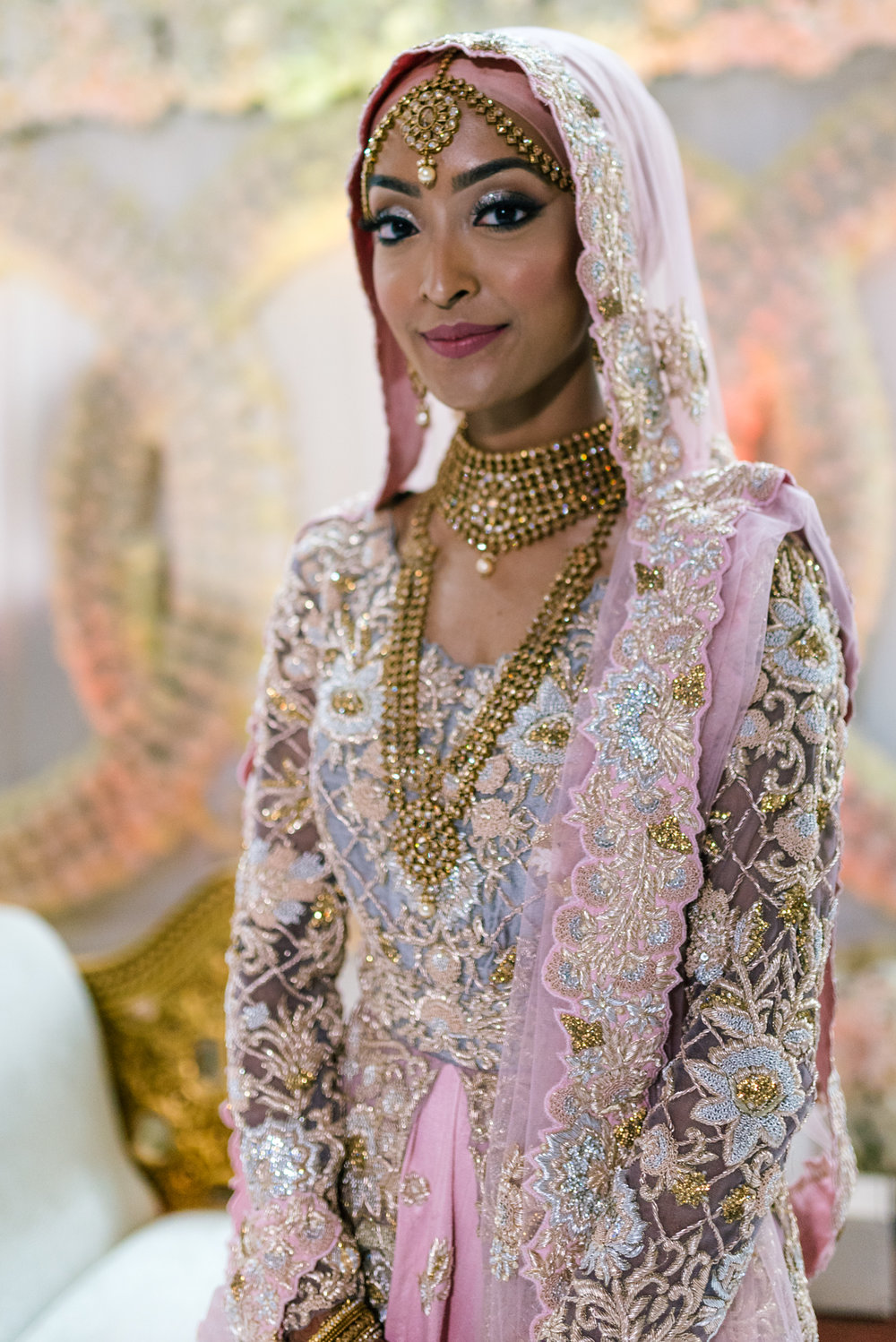 the beautiful indian bride in a spectacular pink and gold indian dress