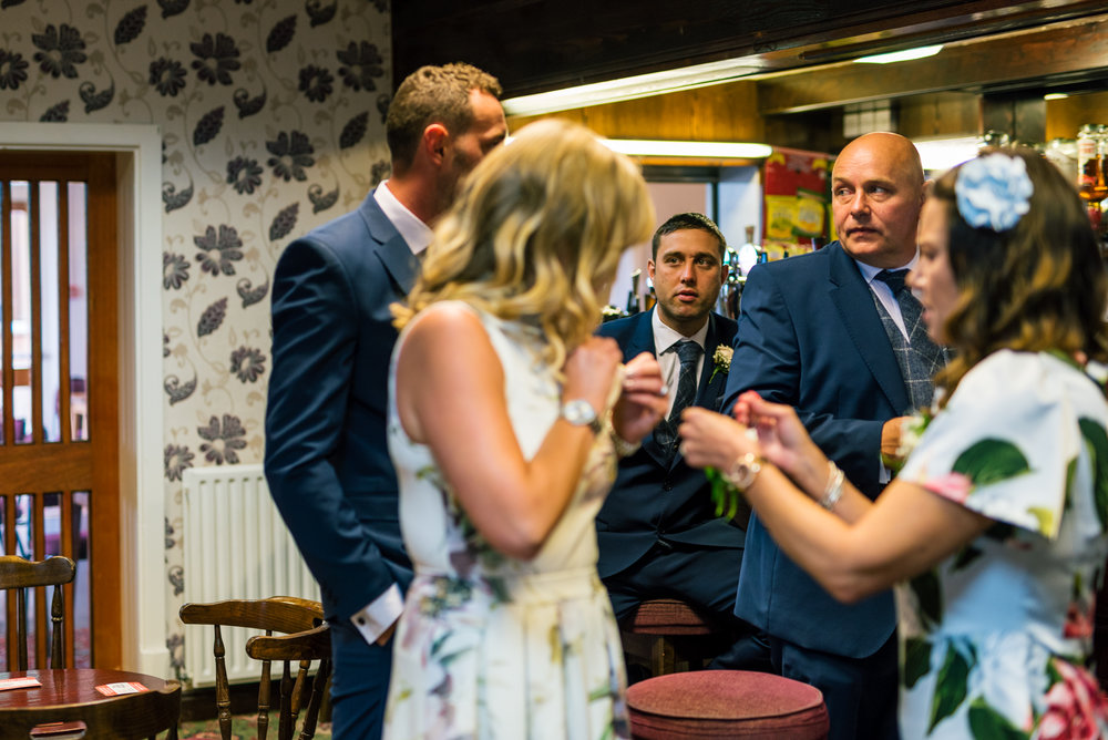 wedding guests waiting in the bar