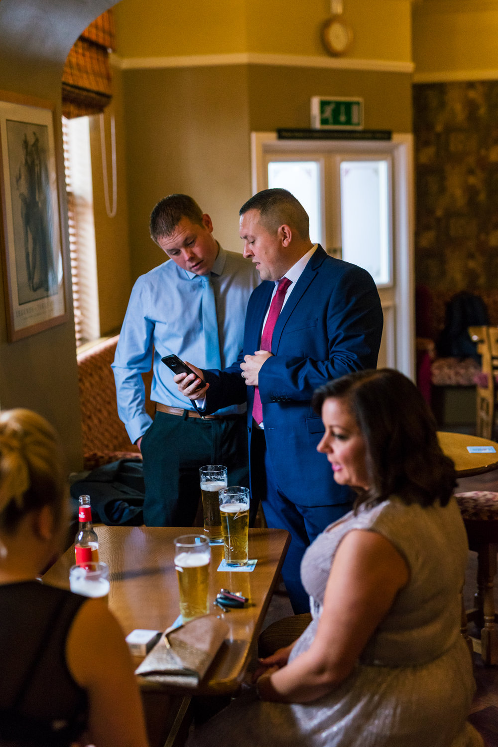 male guests enjoy a drink before the ceremony