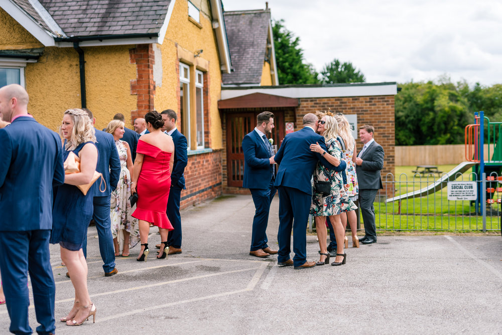 guests waiting outside the church