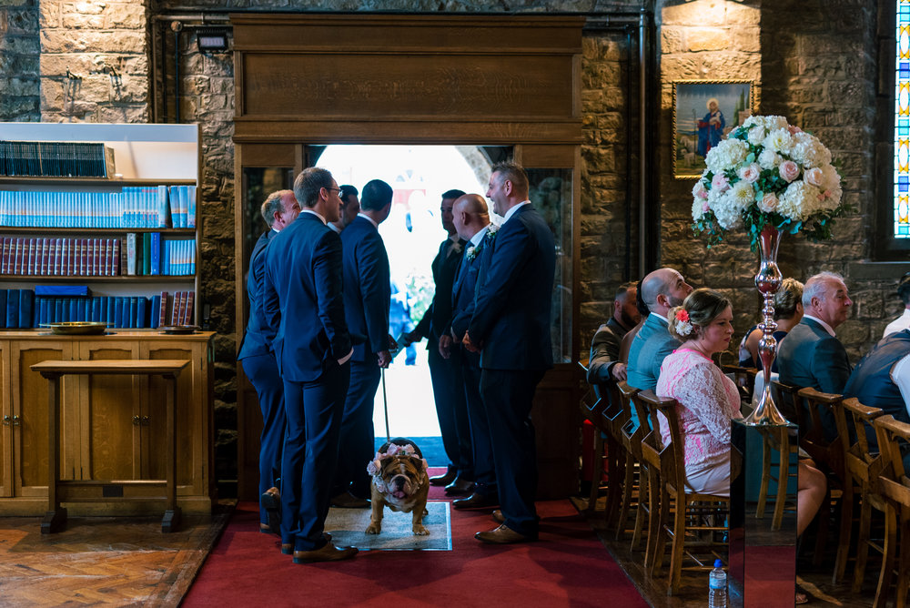 groomsmen give our the orders of service