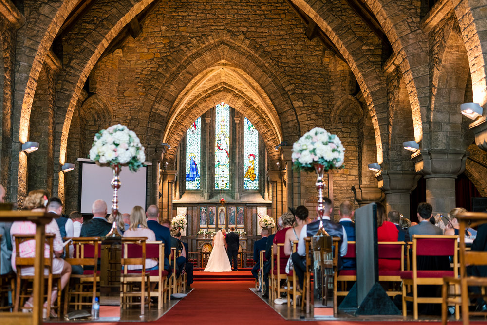 bride and groom getting married in church