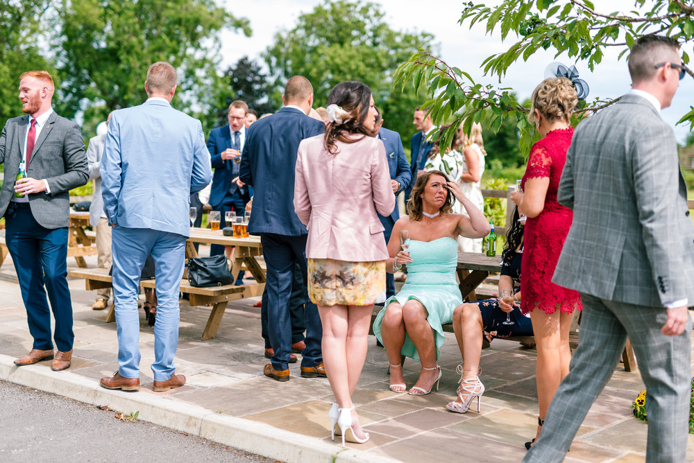 guests start to arrive at the wedding reception venue
