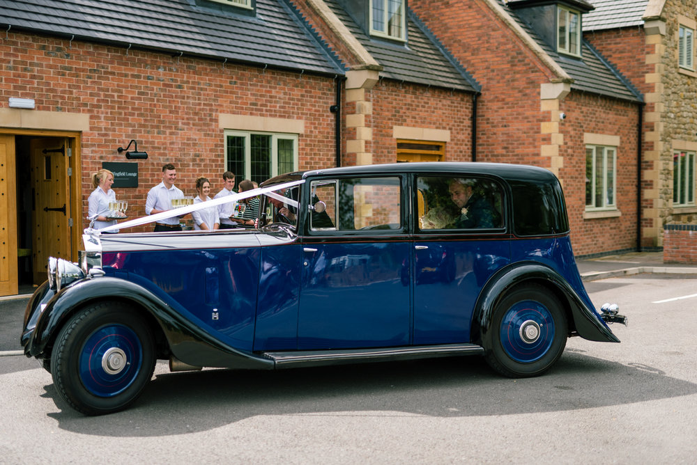 the wedding car arrives at the venue