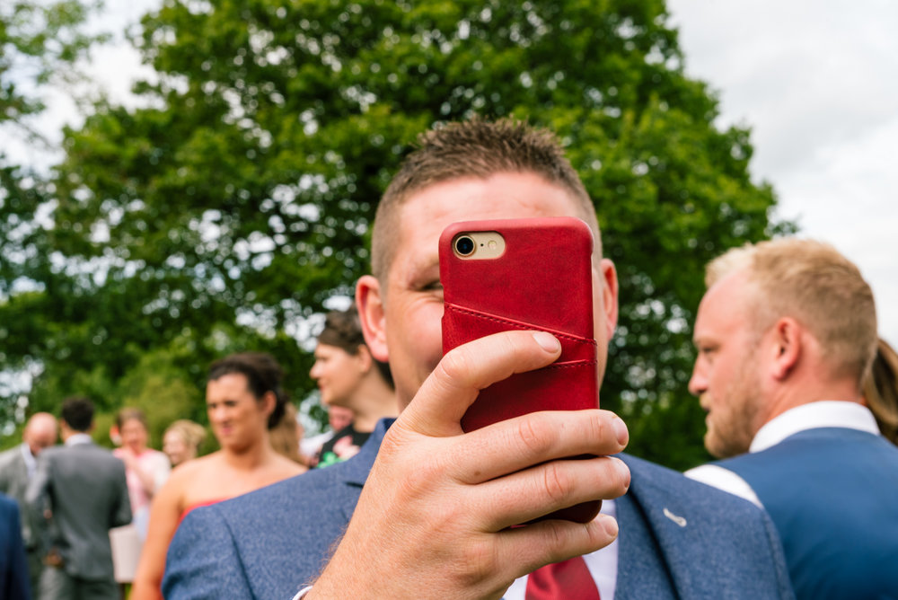 a guest takes a photo of himself