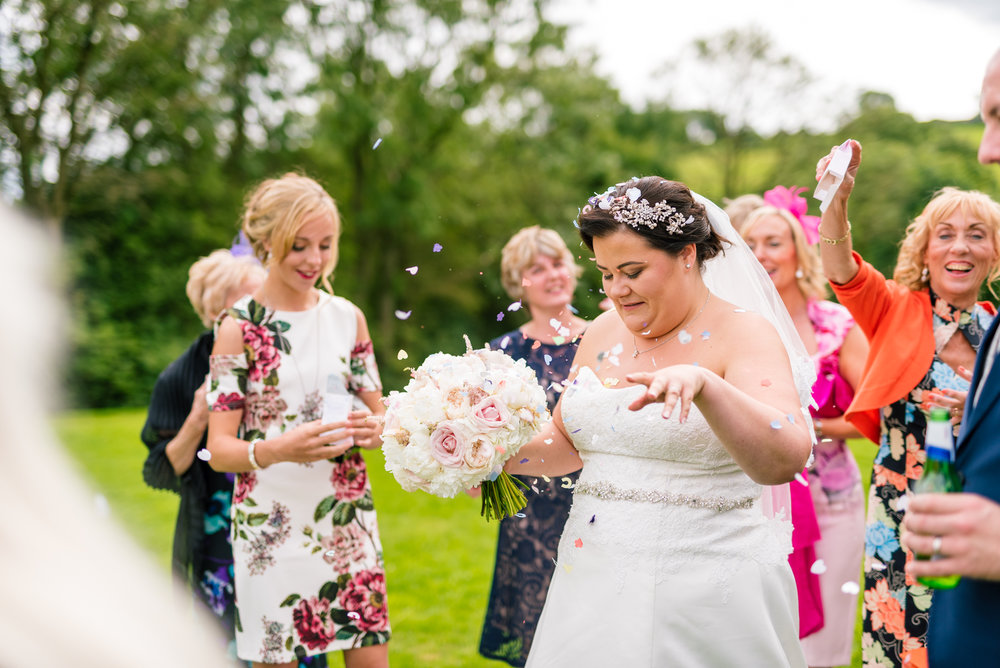 bride tries to get rid of some confetti