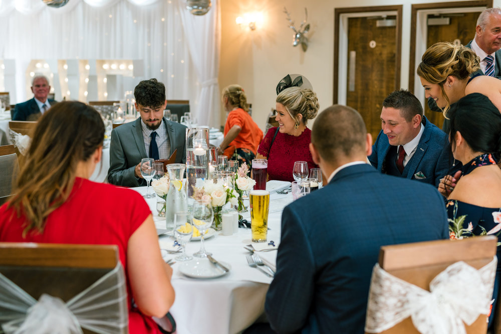 guests sit down to eat