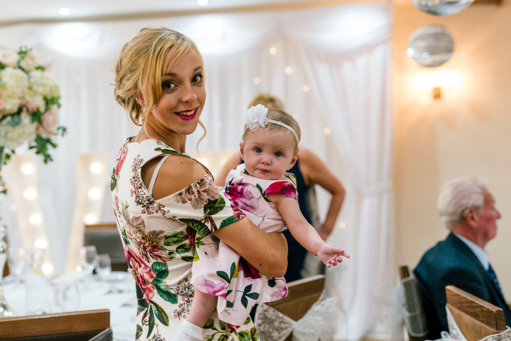wedding guest with her daughter