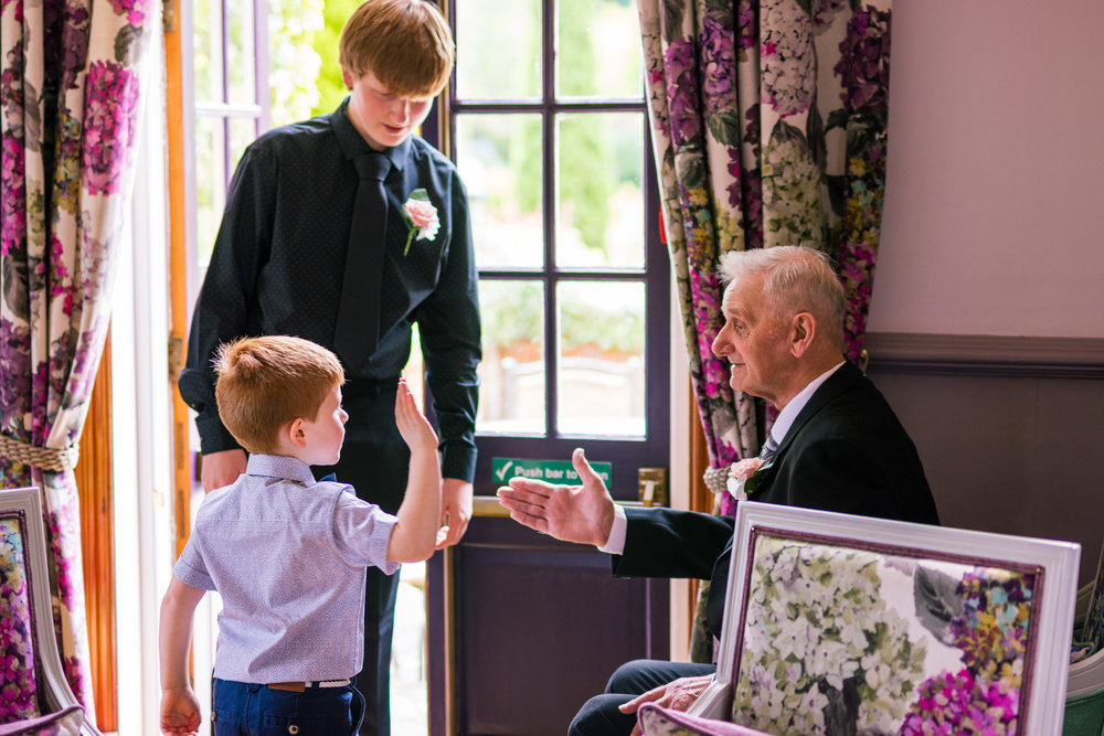 boy and his grandpa doing a high five